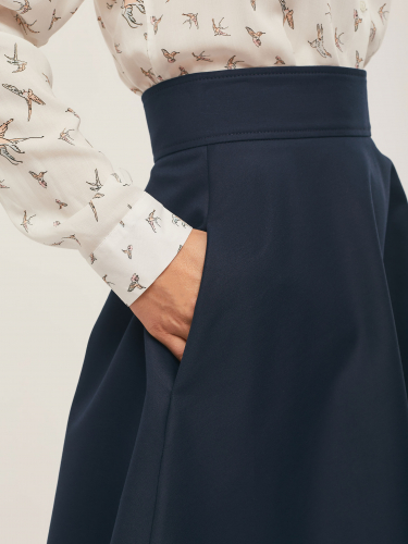 Расклешённая юбка с карманами