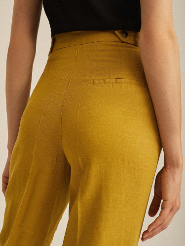 Льняные брюки с защипами