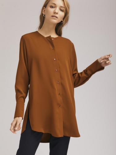 Удлиненная блуза с широкими манжетами