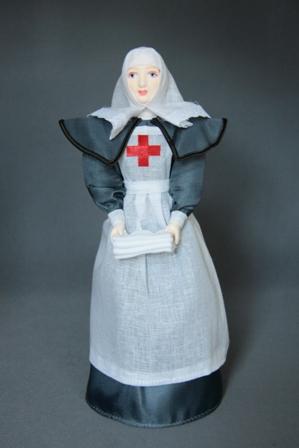 Кукла сувенирная фарфоровая. Сестра милосердия. Форменное платье. К.19-н. 20 в. Россия.