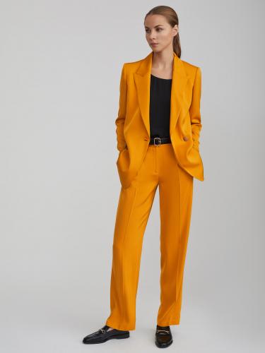 Широкие брюки с защипами