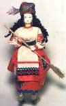 Кукла сувенирная фарфоровая. Баба Яга на  ступе с помелом . Фольклорный персонаж.