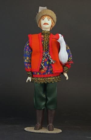 Кукла сувенирная фарфоровая. Парень с гусем.